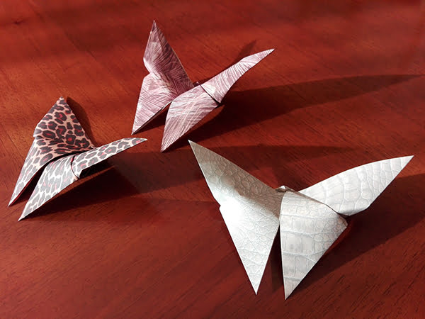 Three origami butterflies on table