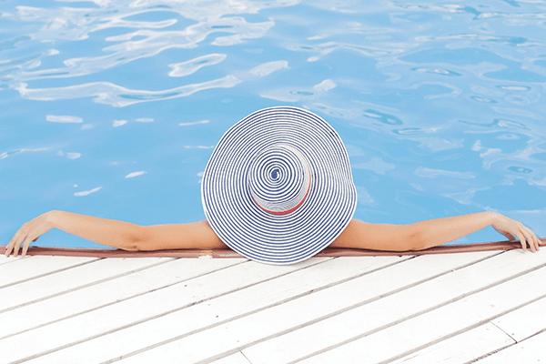 lady sunbathing in the pool